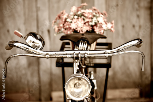 Wall mural Old bicycle and flower  vase