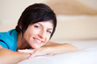 smiling middle aged woman lying on bed relaxing