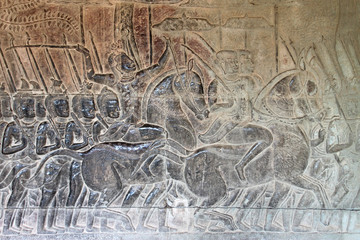 Carvings on wall and terrace of Angkor Wat