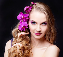 woman with an orchid