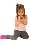Toddler girl sending sms text