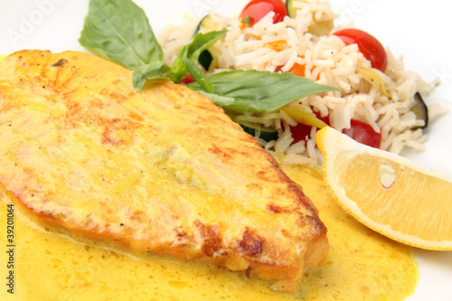 salmon steak in a creamy saffron sauce