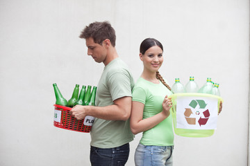 Couple holding containers with bottles