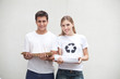 Couple holding piles of paper