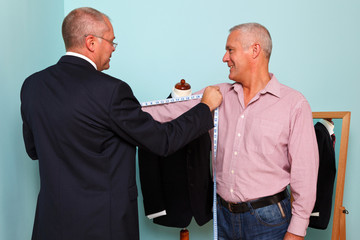 Man being measured for a bespoke suit