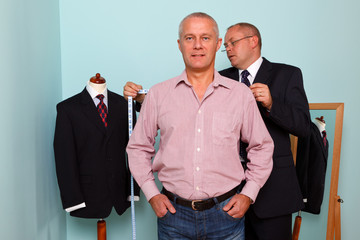 Man being fitted for a bespoke suit