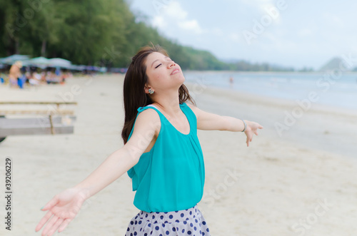 Attractive woman enjoy the beach