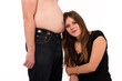 girl leaning against her boyfriends belly