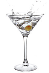 Splashing Martini with olive isolated on white