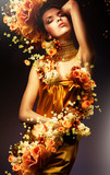 Fototapety sensual woman in long yellow dress and flowers