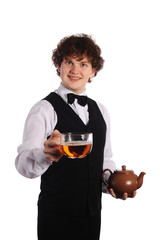 waiter with brown ceramic teapot and big cup