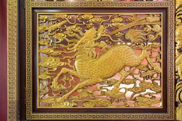 Wood Carved Qilin on Chinese Temple Wall