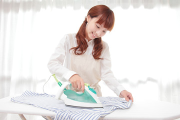 Young Asian women to the ironing