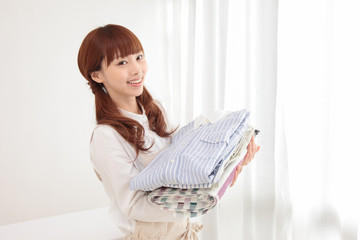 Young Asian woman with laundry
