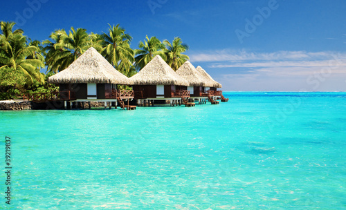 Over water bungalows with steps into amazing lagoon - 39219837