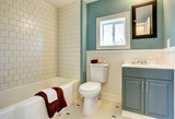 Fototapety New remodeled blue bathroom with classic white tile.