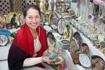 Woman chooses egyptian souvenir