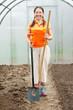 Mature gardener   in greenhouse