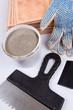 Ceramic tiles and trowel for repairs