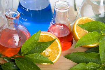 Laboratory flask and orange