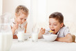 Children eat breakfast