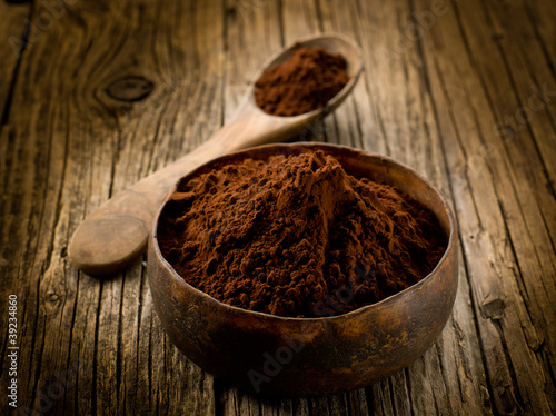 cacao powder on wood bowl