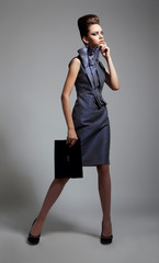 Beautiful fashionable young woman in stylish dress posing