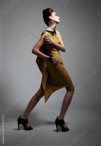 Fashion style - beauty artistic woman in contemporary dress