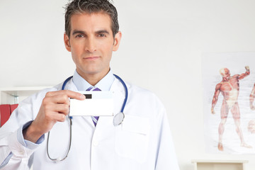 Doctor Holding a Medicine Packet