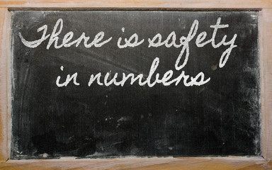 expression -  There is safety in numbers - written on a school b