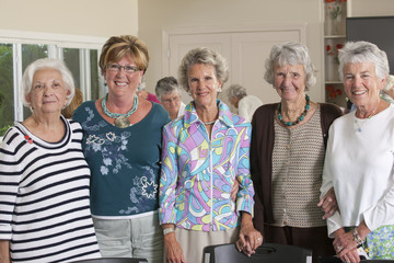 Portrait of senior female friends smiling at a lunch