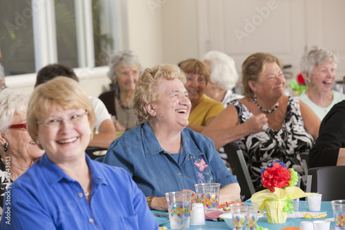 Senior women laughing at a luncheon
