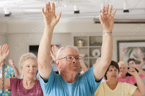 Seniors exercising in a health club