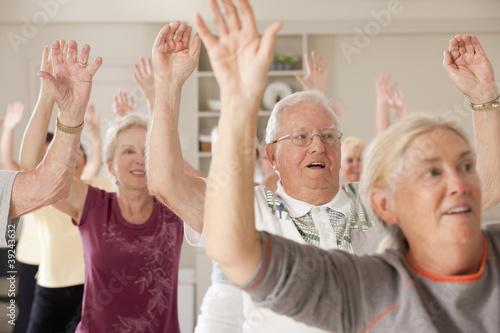 Seniors exercising in a health club
