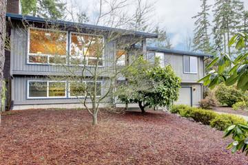 Simple grey brown split level American House.
