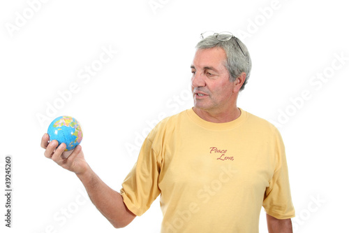 mature man holding globe, protection photo