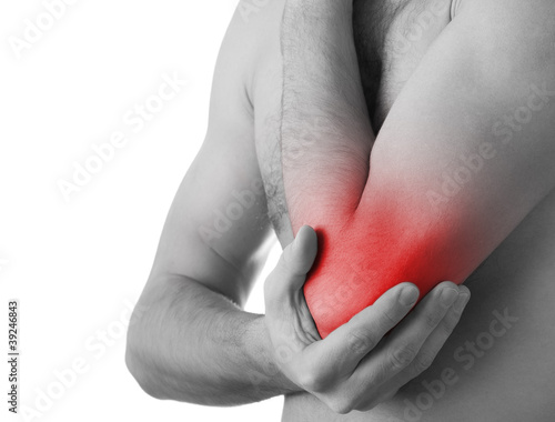 Rear view of a young man holding his elbow in pain, isolated on