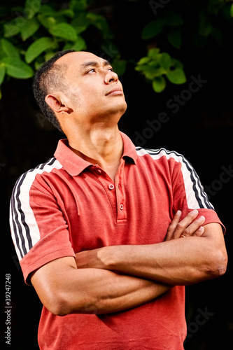 handsome ethnic young man looking up