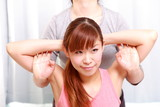 young japanese woman getting chiropractic poster