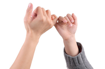 A adult's and a child's hands make the promise sign