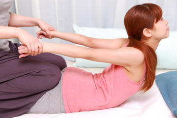 woman getting a thai massage