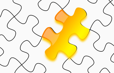 Glossy yellow puzzle on white paper