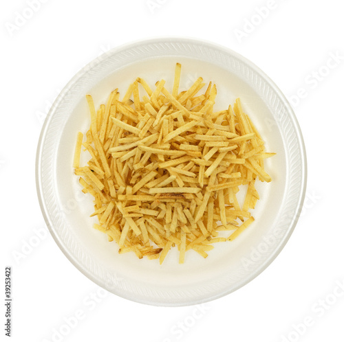 Shoestring potatoes on white plate