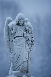 Stone angel atop headstone poster