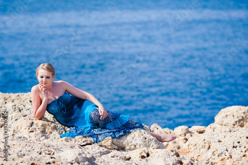 Pretty woman near the sea