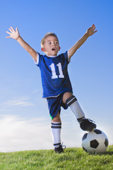 Young Boy soccer player celebrating