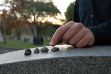 Leaving pebbles on headstone