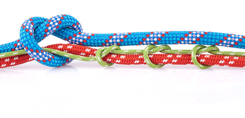 green and blue knots on red rope