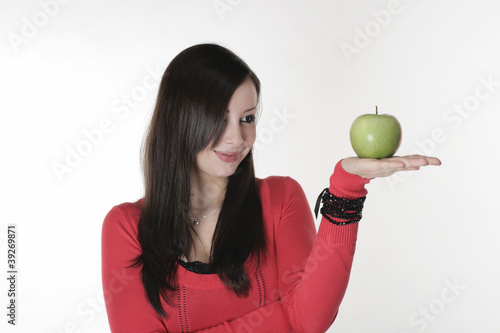 A pretty girl with an apple in her hand
