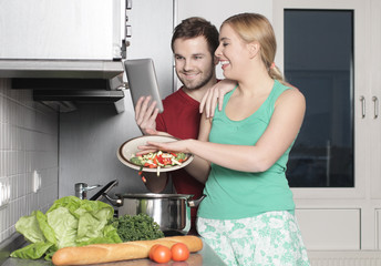 A young couple preparing dinner together